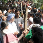 The Prime Minister, Dr. Manmohan Singh meeting the violence affected people in Muzaffarnagar district on September 16, 2013.