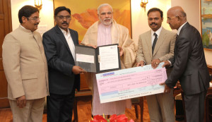 The Founder Chancellor, SRM University, Chennai, Dr. T.R. Pachamuthu calls on the Prime Minister, Shri Narendra Modi, and handed over a demand draft for Rs. 1 crore for the P M NR F